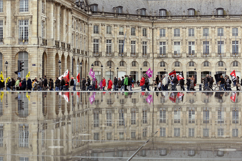 . People demonstrates along the reflecting pool at the Place de la Bourse in Bordeaux, western France, during a May Day rally on May 1, 2014. (NICOLAS TUCAT/AFP/Getty Images)