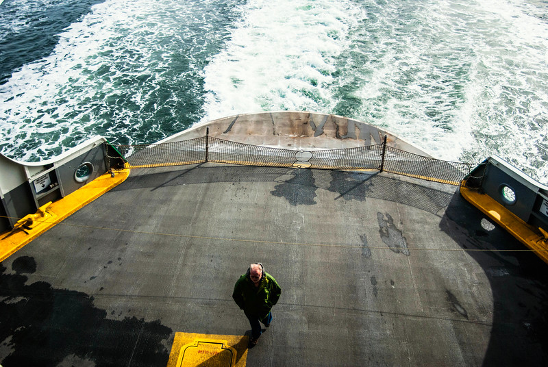 on the ferry looking down man standing.jpg