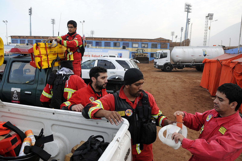 . Rescue personnel get ready to go into action in the northern town of Iquique, Chile, after magnitude 8.2 earthquake struck the northern coast of Chile, Wednesday, April 2, 2014. Authorities lifted tsunami warnings for Chile�s long coastline early Wednesday. Six people were crushed to death or suffered fatal heart attacks, a remarkably low toll for such a powerful shift in the Earth�s crust. (AP Photo/Cristian Viveros)