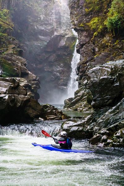 Daphnee Tuzlak gets a workout in Squamish's backyard, paddling around below Mamquam Falls.