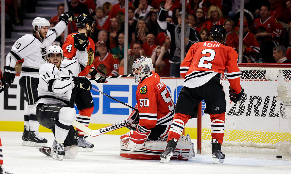 . Los Angeles Kings center Anze Kopitar (11) celebrates his goal against Chicago Blackhawks goalie Corey Crawford (50) during the third period in Game 5 of the NHL hockey Stanley Cup playoffs Western Conference finals, Saturday, June 8, 2013, in Chicago. (AP Photo/Nam Y. Huh)