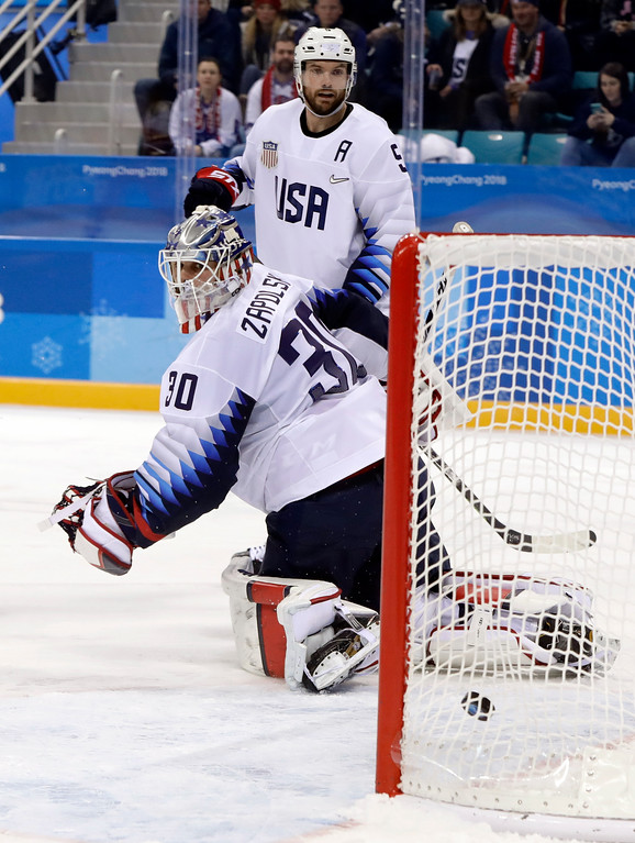. Goalie Ryan Zapolski (30) and Noah Welch (5), of the United States, look at the puck inside of the goal shot by Tomas Kundratek, of the Czech Republic, during the second period of the quarterfinal round of the men\'s hockey game at the 2018 Winter Olympics in Gangneung, South Korea, Wednesday, Feb. 21, 2018. (AP Photo/Matt Slocum)
