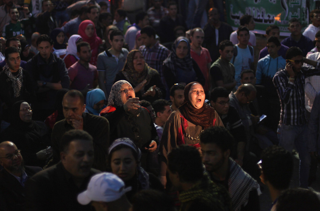. Egyptian protesters chant slogans during a rally of Egyptís April 6 Youth Movement in Mahalla, 125 kilometers (about 77 miles) north of Cairo, Egypt, Saturday, April 6, 2013. Thousands of activists took to the streets Saturday to mark the fifth anniversary of the founding of a leading opposition group, the April 6 Youth Movement, and to push a long list of demands on Morsi, including the formation of a more inclusive government amid a worsening economy.(AP Photo/Khalil Hamra)