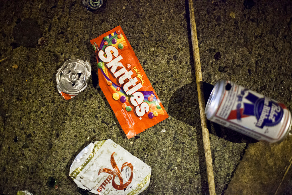 . Beer cans and a Skittles candy wrapper are seen on the street  during a celebration after the Seahawks won the Super Bowl on February 2, 2014 in Seattle, Washington. The Seahawks defeated the Denver Broncos 43-8 in Super Bowl XLVIII.  (Photo by David Ryder/Getty Images)