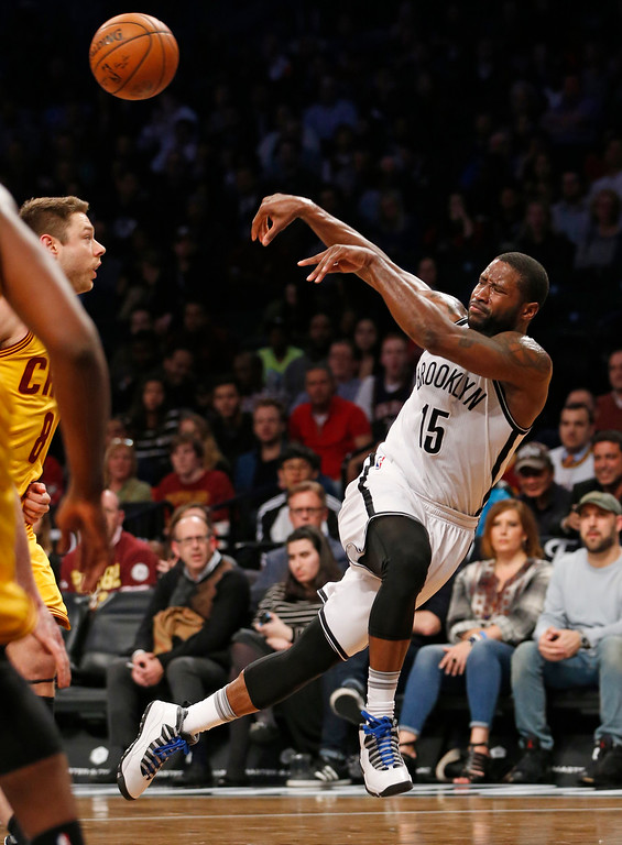 . Brooklyn Nets guard Donald Sloan (15) heaves the ball to the perimeter in the second half of an NBA basketball game, Thursday, March 24, 2016, in New York. The Nets upset the Cavaliers 104-95. (AP Photo/Kathy Willens)