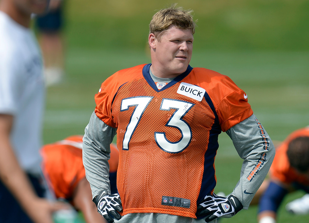 . Denver Broncos guard Chris Kuper (73) stretches during practice August 23, 2013 at Dove Valley (Photo by John Leyba/The Denver Post)