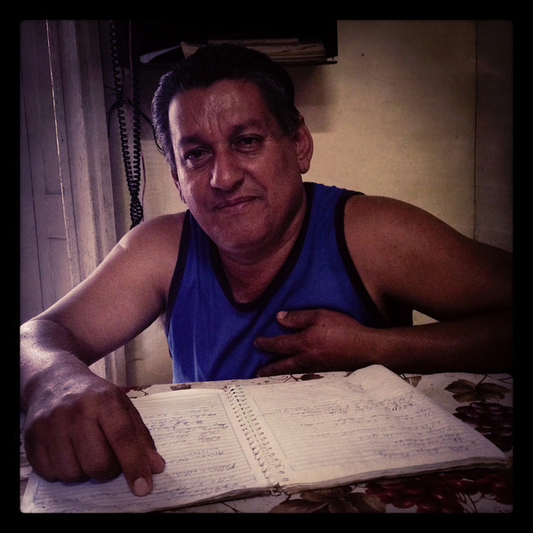 Teodoro reading the phone book