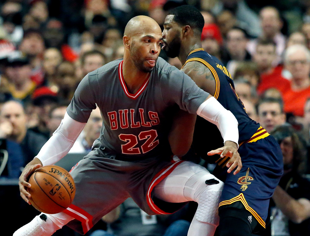 . Chicago Bulls forward Taj Gibson, left, drives against Cleveland Cavaliers forward Tristan Thompson during the second half of an NBA basketball game Friday, Dec. 2, 2016, in Chicago. The Bulls won 111-105. (AP Photo/Nam Y. Huh)