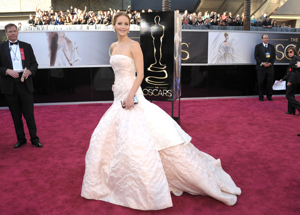 Description of . Actress Jennifer Lawrence arrives at the 85th Academy Awards at the Dolby Theatre on Sunday Feb. 24, 2013, in Los Angeles. (Photo by John Shearer/Invision/AP)