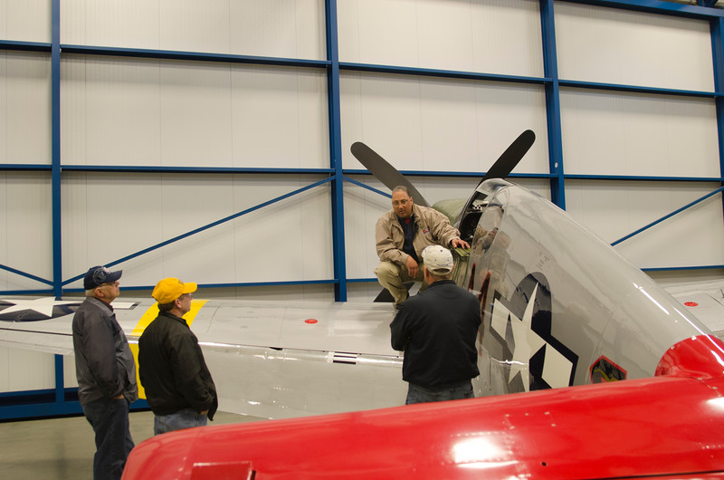 Bill Shepard discussing the P-51C Mustang with visitors