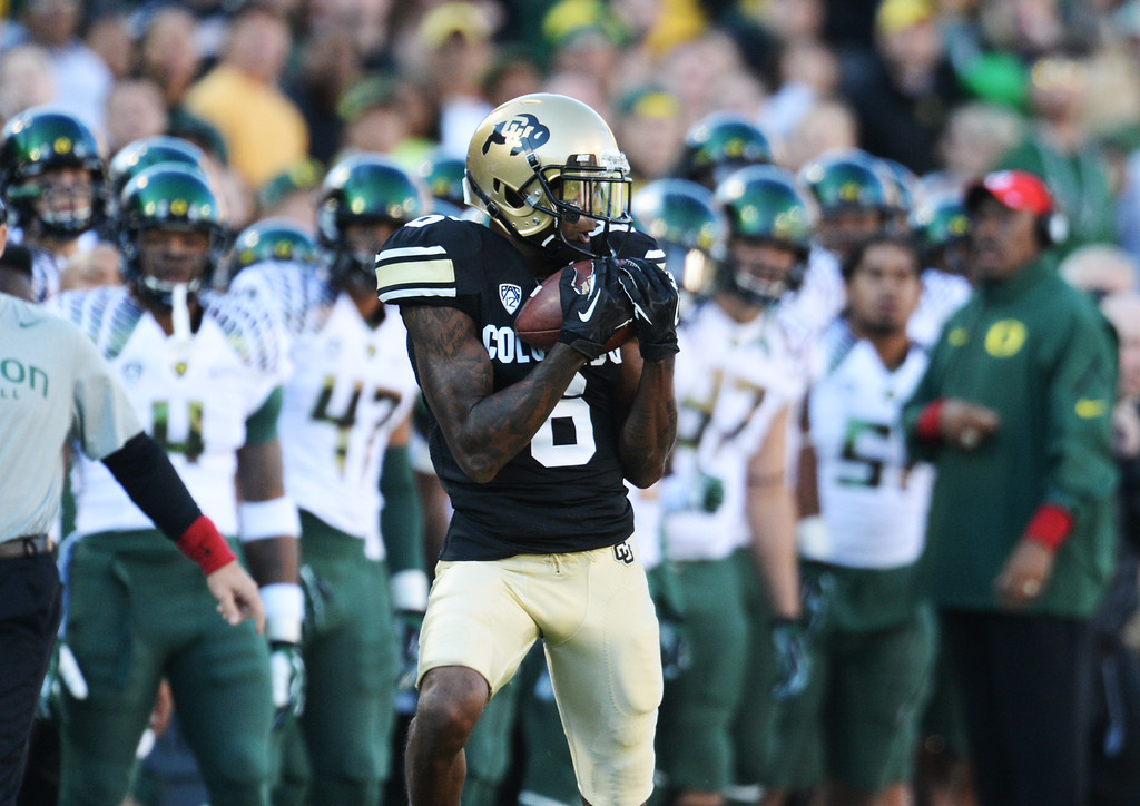 . WR Paul Richardson of University of Colorado (6) catches a pass from QB Connor Wood (5) in the 1st quarter  against University of Oregon at Folsom Field. Boulder, Colorado. October 5, 2013. Oregon won 57-16. (Photo by Hyoung Chang/The Denver Post)