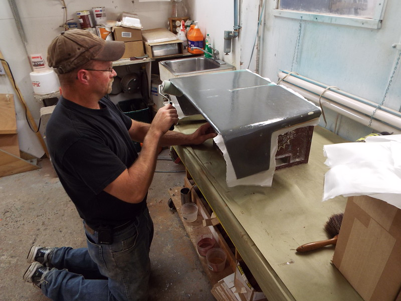 cover the instrument panel with a layer of glass and four coats of polyester resin.