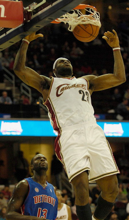 . Michael Blair/MBlair@News-Herald.com The Cavs\' LeBron James slam dunks the ball over the Piston\'s Nazr  Mahammed during the second quarter of Thursday\'s game at The Q.