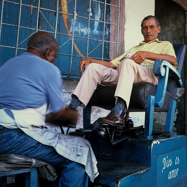 CU Man REclining on Shoe Shine Chair Cien Fuegos Cuba Mar 2006 H.jpg