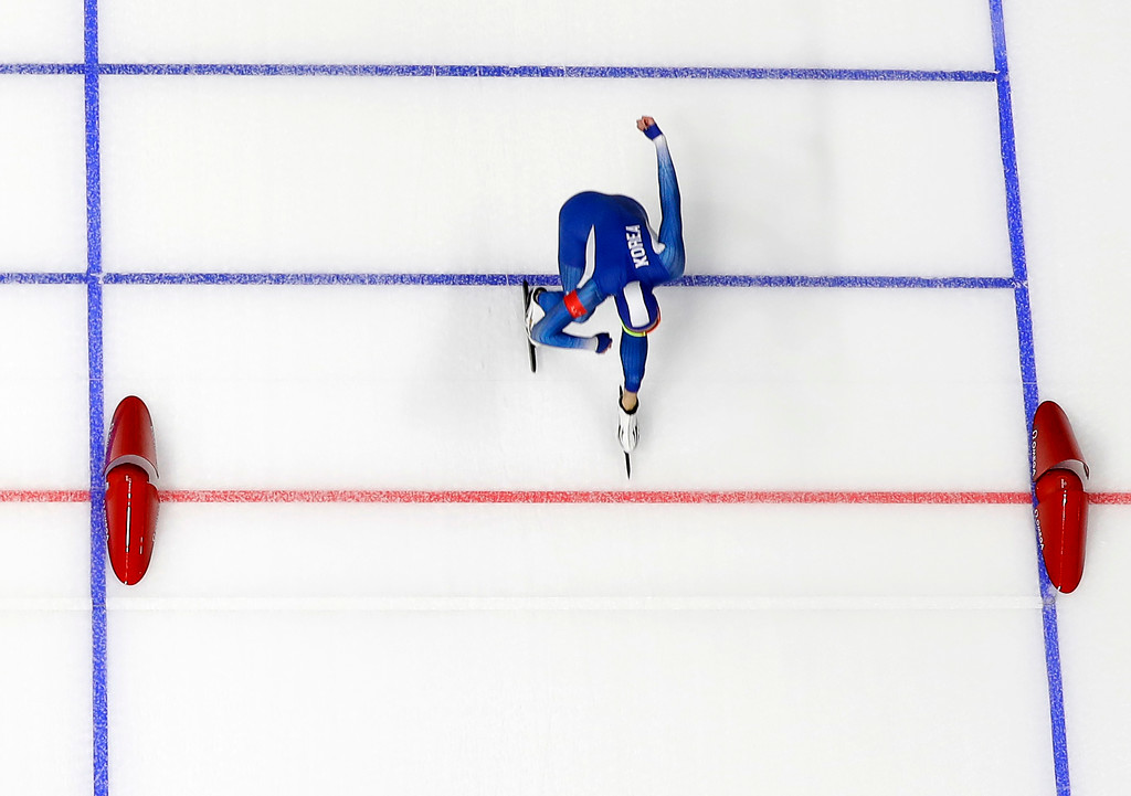 . Cha Min-kyu of South Korea pushes his skate over the finish line to set a new Olympic record during the men\'s 500 meters speedskating race at the Gangneung Oval at the 2018 Winter Olympics in Gangneung, South Korea, Monday, Feb. 19, 2018. (AP Photo/Eugene Hoshiko)