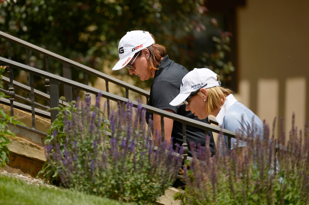 . Maria Hjorth representing Sweden talks with vice captain Annika Sorenstam of the 2013 European Solheim Cup Team after their first 9 holes during a look the course at Colorado Golf Club in Parker, Colorado,  where they will play the Americans for the Solheim Cup. The tournament runs from August 13th through the 19th. (Photo By Joe Amon/The Denver Post)