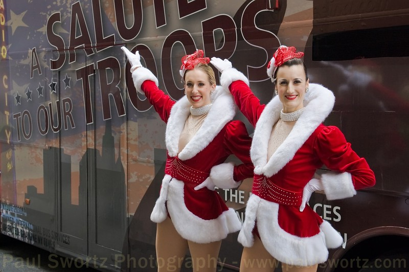 A pair of Radio City Music Hall Rockettes greet the arriving wounded at Pennsylvania Station in New York City.