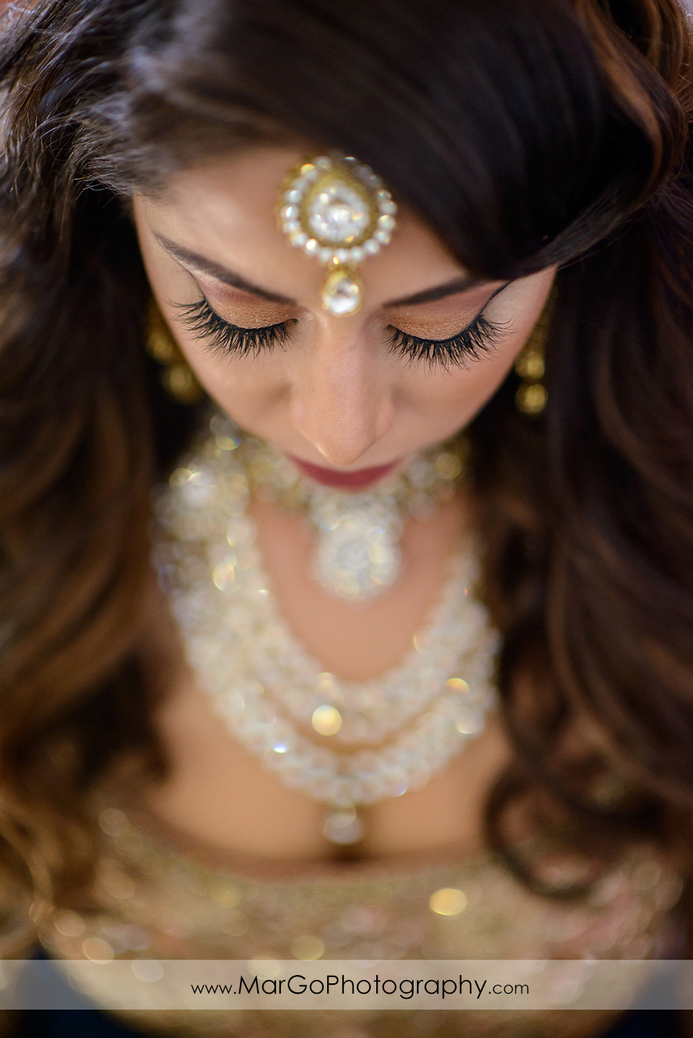 indian bridal portrait with closed eyes at DoubleTree by Hilton Pleasanton at the Club