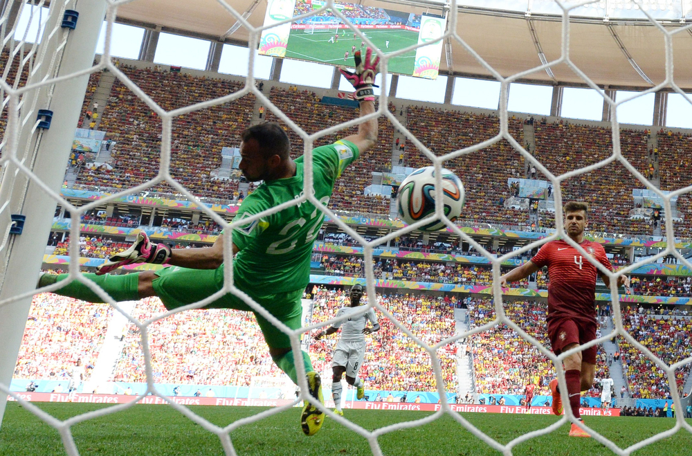 . Portugal\'s goalkeeper Beto (L) fails to save the ball during the Group G football match between Portugal and Ghana at the Mane Garrincha National Stadium in Brasilia during the 2014 FIFA World Cup on June 26, 2014. (CARL DE SOUZA/AFP/Getty Images)