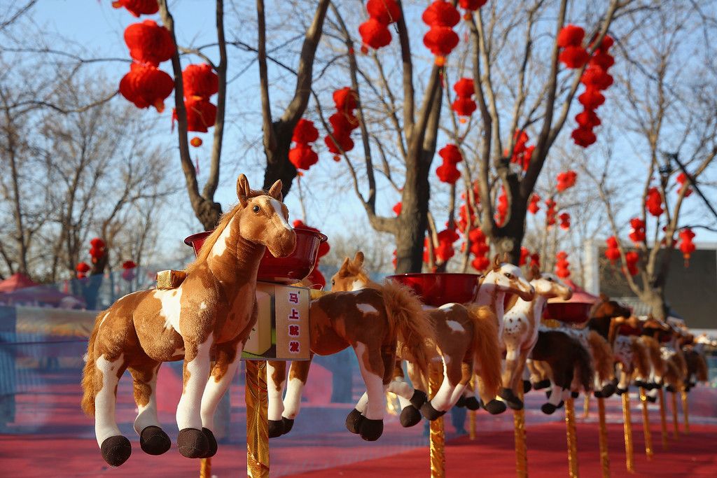 . The horse toys are seen at a game area of the Spring Festival Temple Fair for celebrating Chinese Lunar New Year of Horse at the Temple of Earth park on January 30, 2014 in Beijing, China.   (Photo by Feng Li/Getty Images)