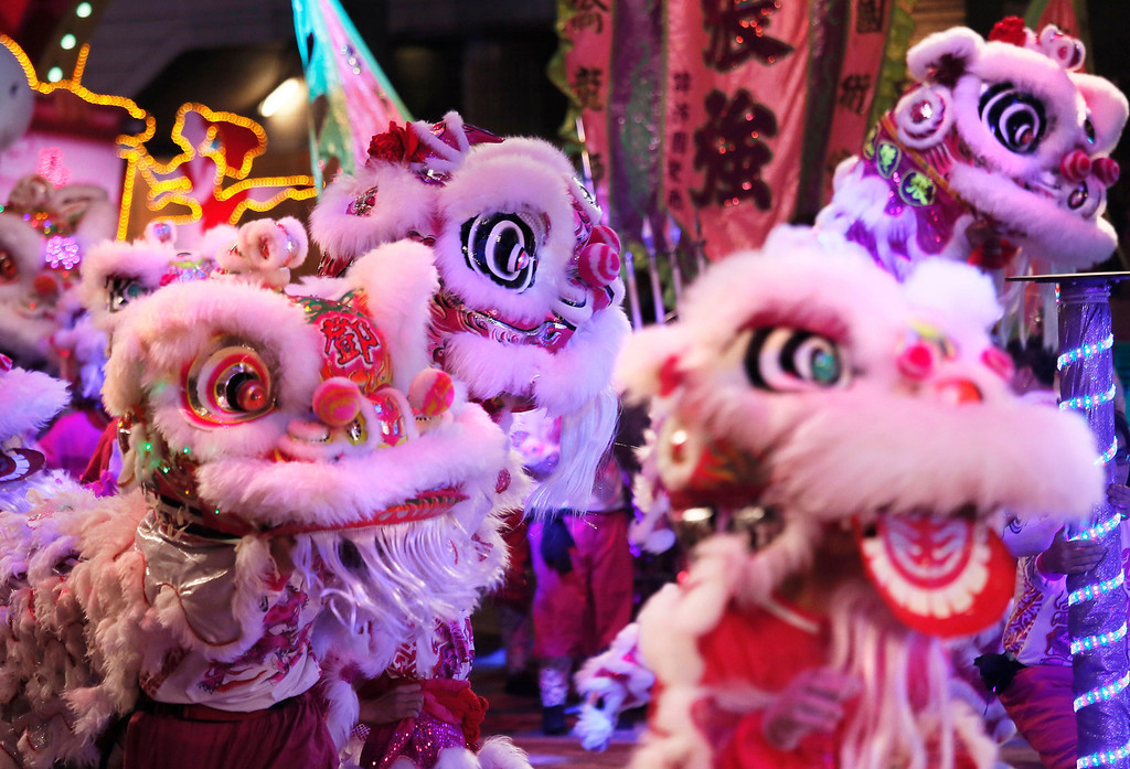 . Lion dancers take part in a night parade to celebrate Chinese New Year in Hong Kong, Friday, Jan. 31, 2014.  (AP Photo/Vincent Yu)