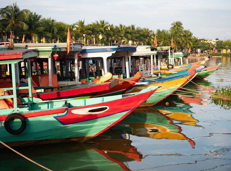 Colorful Painted Wooden Boats in the Thu Bon River