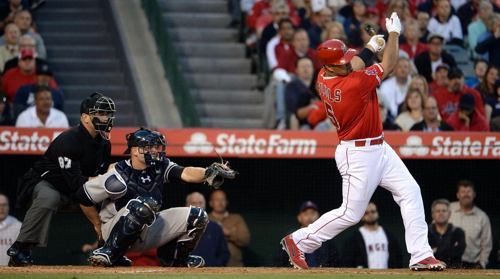 . Los Angeles Angels\' Albert Pujols singles in the first inning of a baseball game against the New York Yankees at Anaheim Stadium in Anaheim, Calif., on Tuesday, May 6, 2014.  (Keith Birmingham Pasadena Star-News)