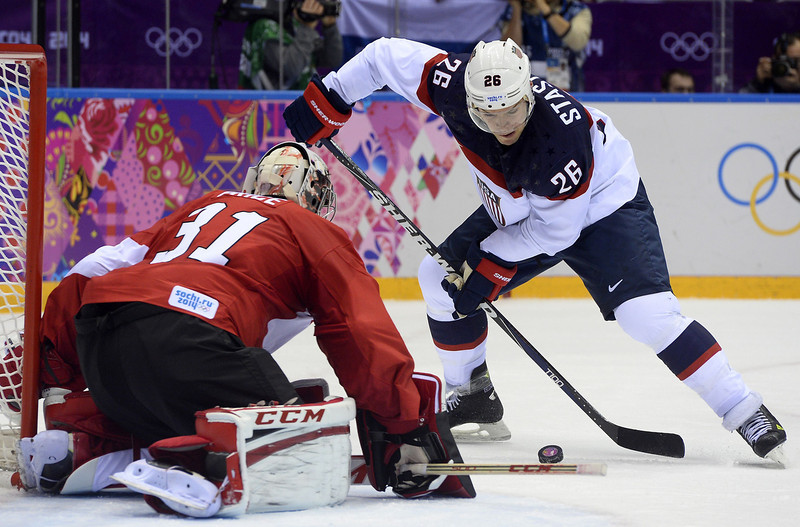 . US Paul Stastny (R) comfronts Canada\'s goalkeeper Carey Price during the Men\'s Ice Hockey Semifinal match between the USA and Canada at the Bolshoy Ice Dome during the Sochi Winter Olympics on February 21, 2014.  JONATHAN NACKSTRAND/AFP/Getty Images