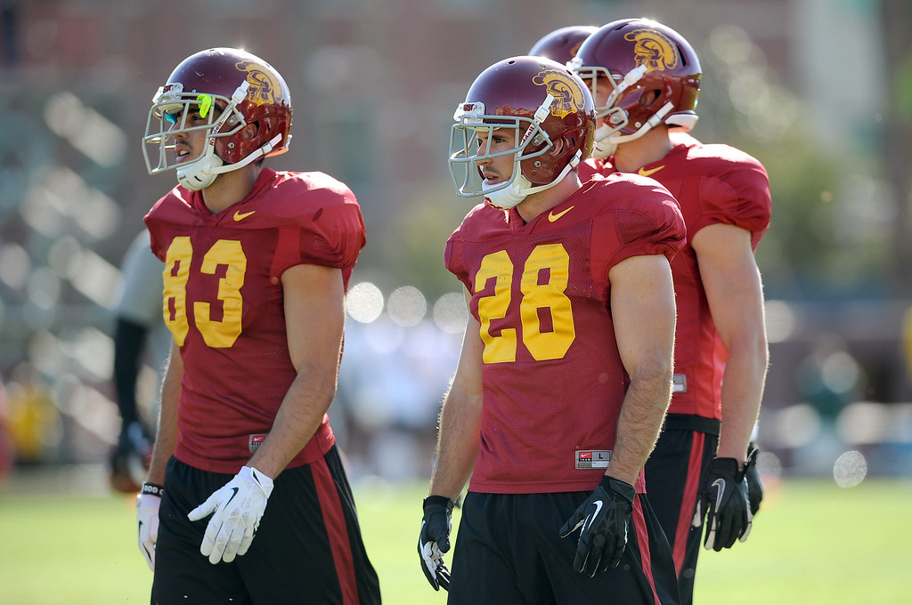. USC\'s Christian Tober and George Katrib look on during spring practice at USC Monday, April 1, 2014. (Andy Holzman/Los Angeles Daily News)