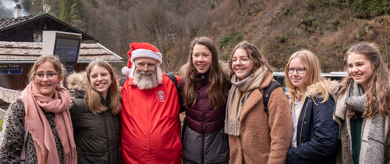 TBDBITL Santa graciously posed with a flock of young tourists