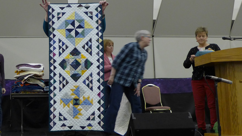 Ruby Freed made this table runner from orphan blocks in her collection.
