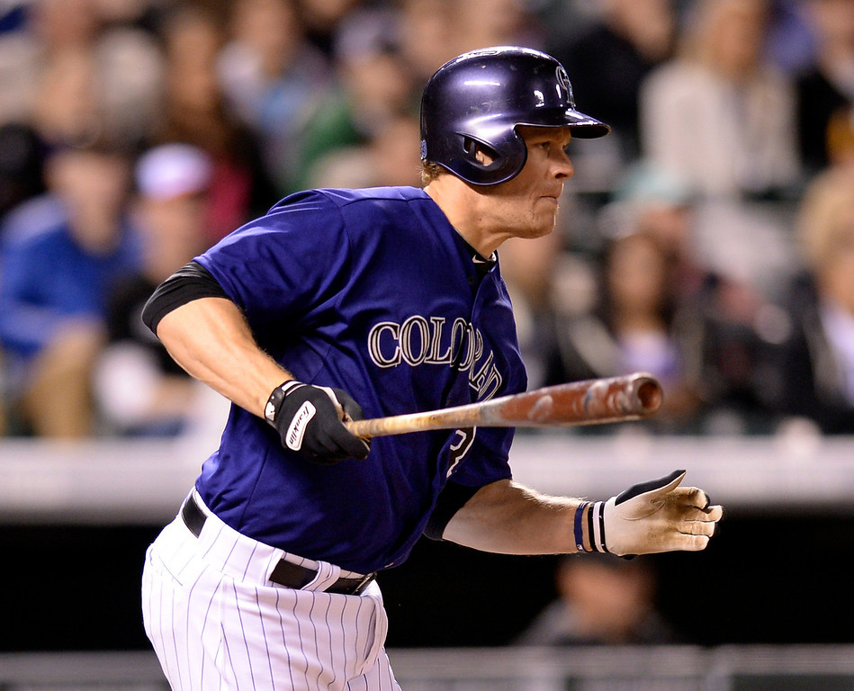 . Colorado batter Justin Morneau singled up the middle in the seventh inning. The Chicago White Sox clobbered the Colorado Rockies 15-3 Tuesday night, April 8, 2014 at Coors Field in Denver.  (Photo by Karl Gehring/The Denver Post)