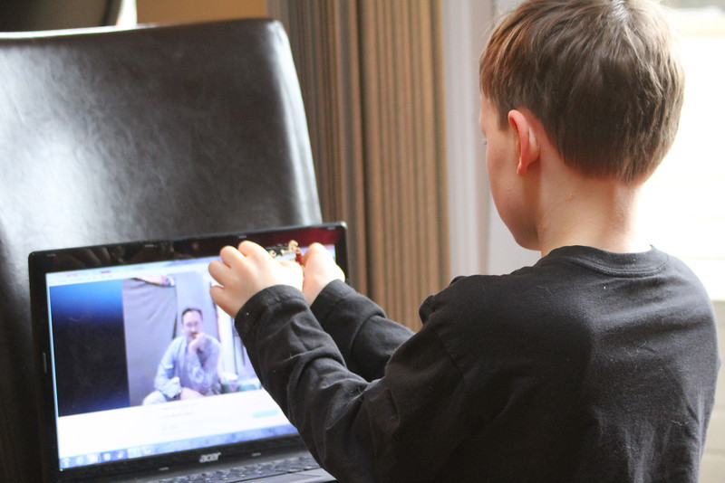 Aaron showing his Dad some Lego thing on Skype