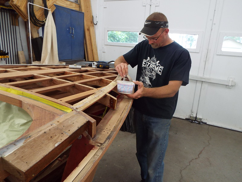 Applying epoxy to the deck frames before the blocks are installed.