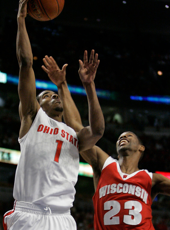 . Ohio State guard Mike Conley Jr. (1) goes up to score against Wisconsin guard Kammron Taylor during the first half of the Big Ten Tournament championship basketball game in Chicago, Sunday, March 11, 2007.  (AP Photo/Brian Kersey)