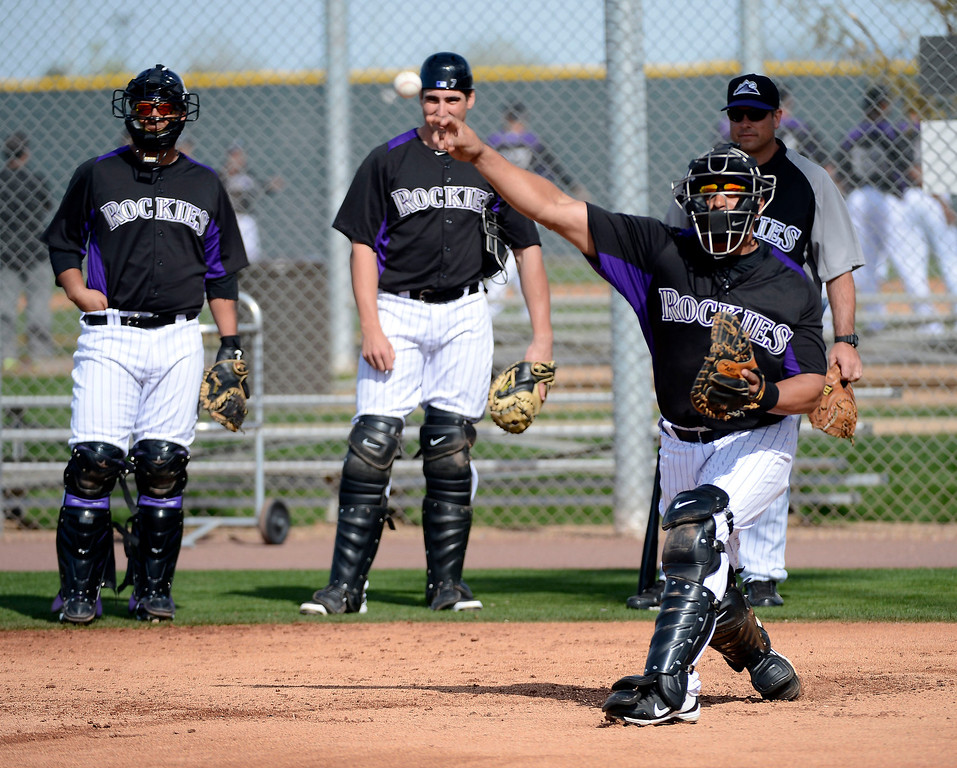 . SCOTTSDALE, AZ. - FEBRUARY 19: Colorado Rockies Yorvit Torrealba (8) throws over to third during team fundamental February 19, 2013 in Scottsdale. (Photo By John Leyba/The Denver Post)