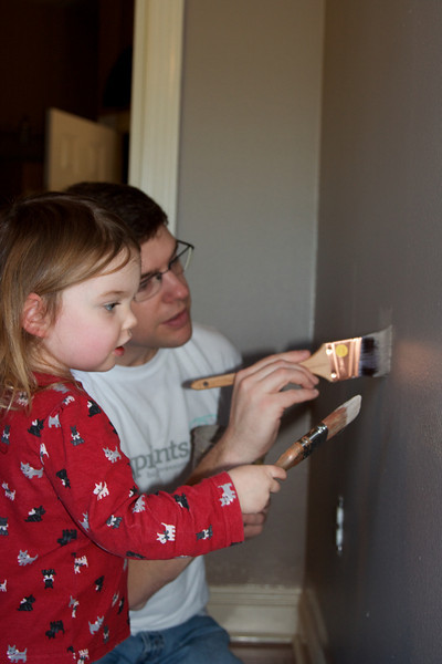 Daddy showing Anna how the correct paintbrush strokes