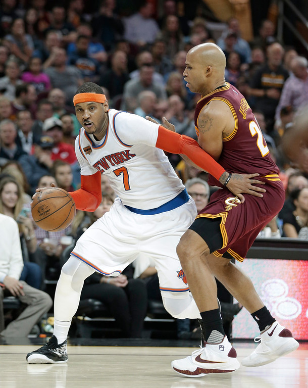 . New York Knicks\' Carmelo Anthony (7) drives against Cleveland Cavaliers\' Richard Jefferson (24) in the second half of an NBA basketball game, Thursday, Feb. 23, 2017, in Cleveland. (AP Photo/Tony Dejak)