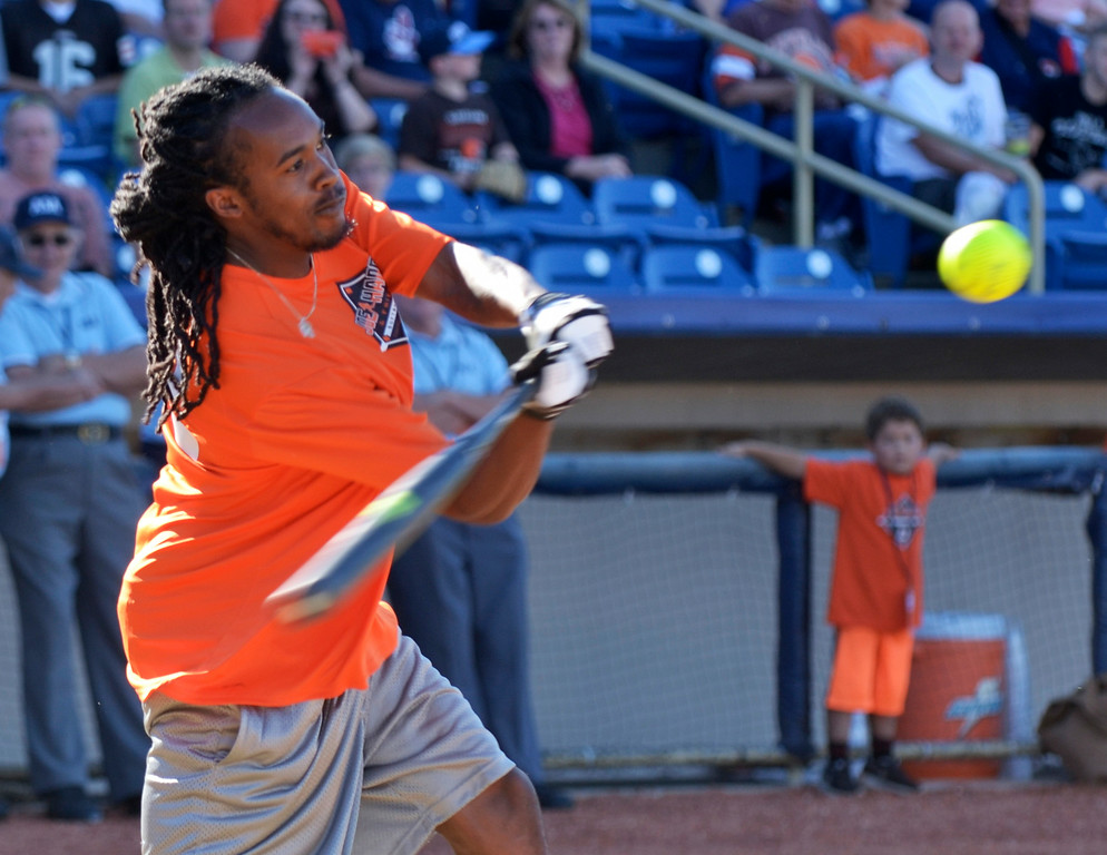 . Jeff Forman/JForman@News-Herald.com Travis Benjamin competes in the home run derby before the Joe Haden and Friends Softball Game July 17 at Classic Park.