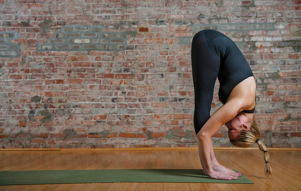 . Sun salutation, left to right:   11) Exhale and fold forward over your legs. You should find your hamstrings more accommodating then they were even a few seconds ago. (Photo for The Washington Post by Amanda Voisard.)