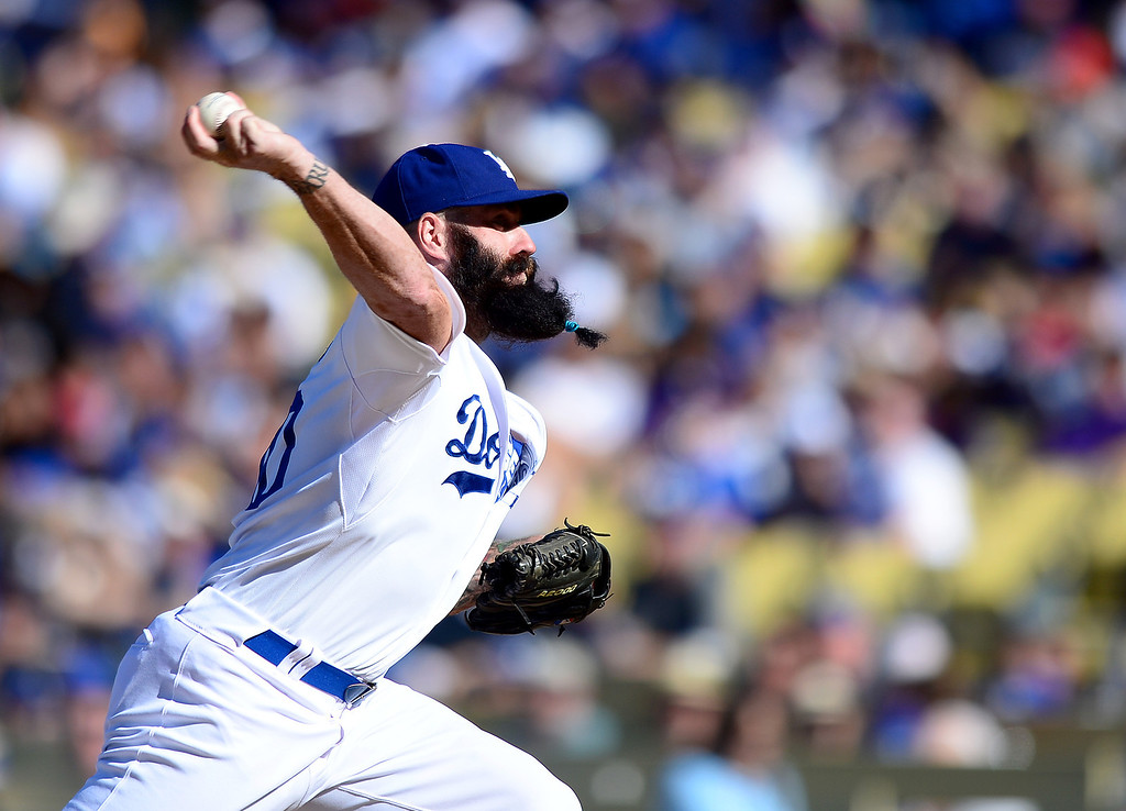 . Dodgers\' Brian Wilson #00 pitches to the Rockies as the Rockies defeat the Dodgers 2-1 at Dodger Stadium during their final game of the regular season Sunday, September 29, 2013. (Photo by Sarah Reingewirtz/Pasadena Star-News)