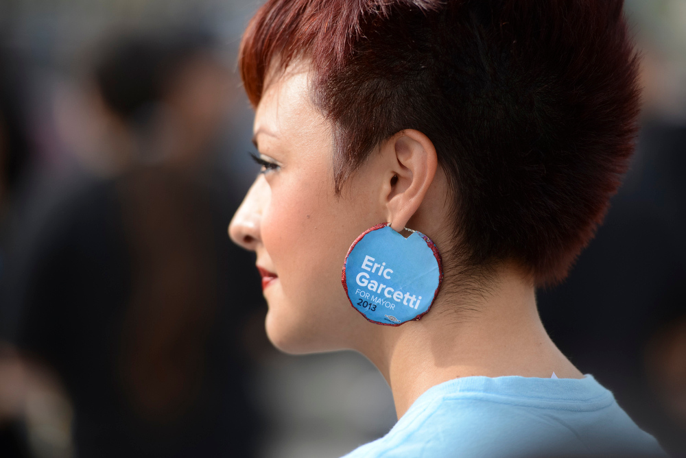 . Eric Garcetti supporters Olivia Rubio sports Garcetti earrings  at a campaign stop in Los Angeles Sunday.  Garcetti is running for Los Angeles mayor.  The election is Tuesday.   Photo by David Crane/Staff Photographer