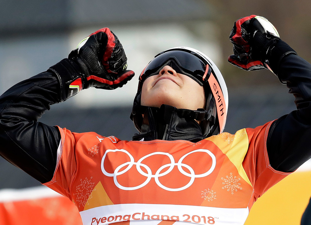 . Silver medal winner Lee Sangho, of South Korea, celebrates after competing in the men\'s parallel giant slalom semifinal at Phoenix Snow Park at the 2018 Winter Olympics in Pyeongchang, South Korea, Saturday, Feb. 24, 2018. (AP Photo/Lee Jin-man)
