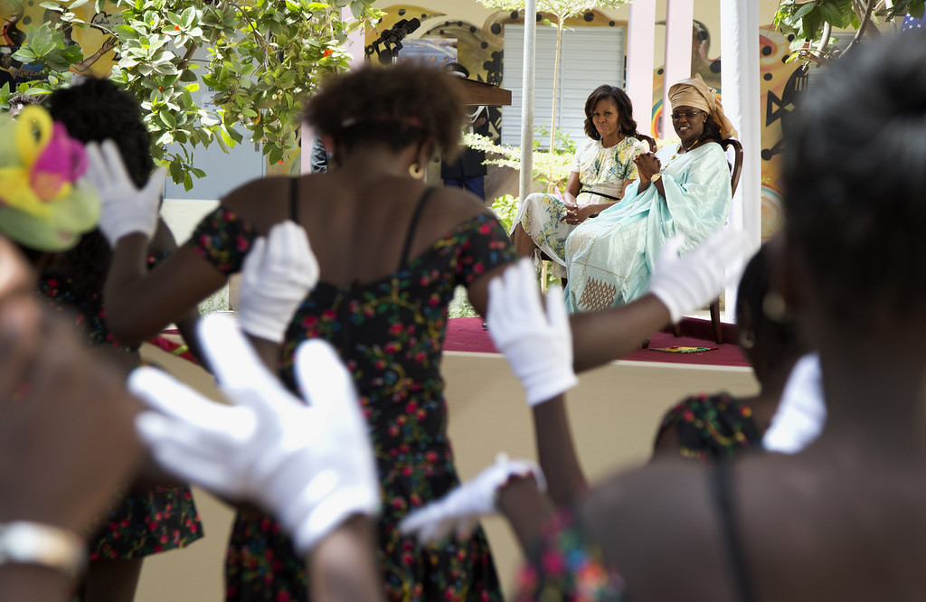 . First lady Michelle Obama and Senegal\'s first lady Marieme Faye Sall watch students dance during a visit to the all-girls Martin Luther King Middle School, Thursday, June 27, 2013, in Dakar, Senegal. (AP Photo/Carolyn Kaster)