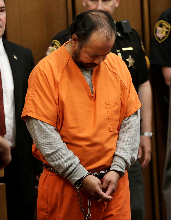 . Ariel Castro walks into the courtroom for his arraignment Wednesday, June 12, 2013, in Cleveland. Castro, who held 3 women captive for a decade, has committed suicide, Tuesday, Sept. 3, 2013.  (AP Photo/Tony Dejak)