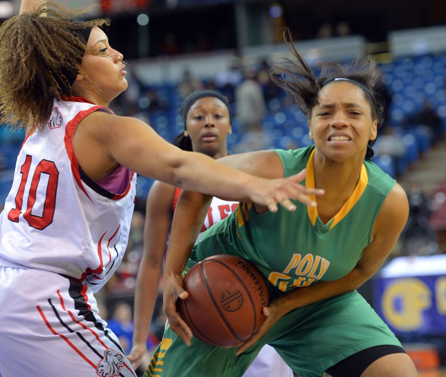 . Poly\'s Jada Matthews is guarded by Salesian\'s Alana Horton at Sleep Train Arena in Sacramento, CA on Saturday, March 29, 2014. Long Beach Poly vs Salesian in the CIF Open Div girls basketball state final. 1st half. (Photo by Scott Varley, Daily Breeze)