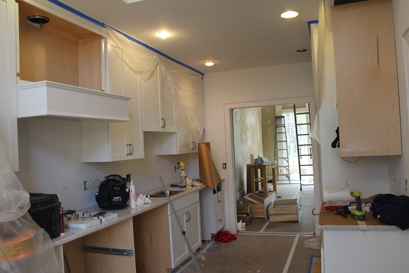 """kitchen with new cabinets (some had to be """"reordered"""" as they didn't fit correctly) - plan to paint walls a sort of sage green"""