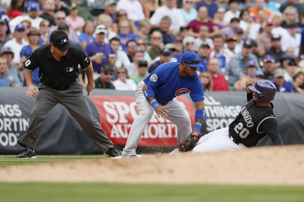 . Chicago Cubs third baseman Luis Valbuena #24 tags out Colorado Rockies catcher Wilin Rosario #20 in the bottom of the 5th inning at Coors Field on August 7, 2014 in Denver, Colorado. The Chicago Cubs defeated the Colorado Rockies 6-2. (Photo by Trevor Brown, Jr./Getty Images)