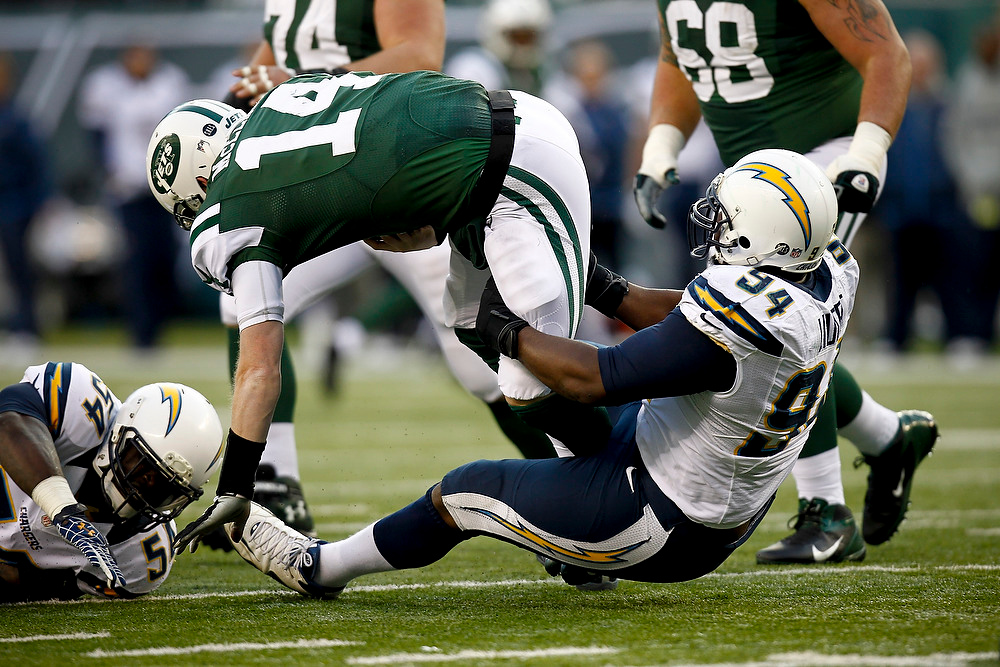 . Corey Liuget #94 of the San Diego Chargers sacks Greg McElroy #14 of the New York Jets at MetLife Stadium on December 23, 2012 in East Rutherford, New Jersey. (Photo by Jeff Zelevansky /Getty Images)