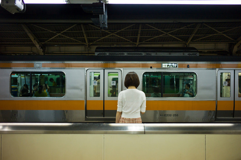 Girl waiting for train. Shinjuku.